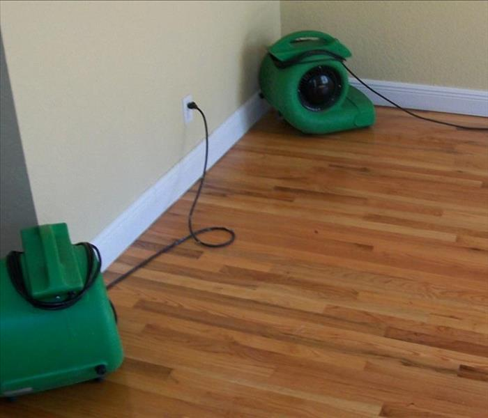 two air movers completing the drying, the floor looks new and dry