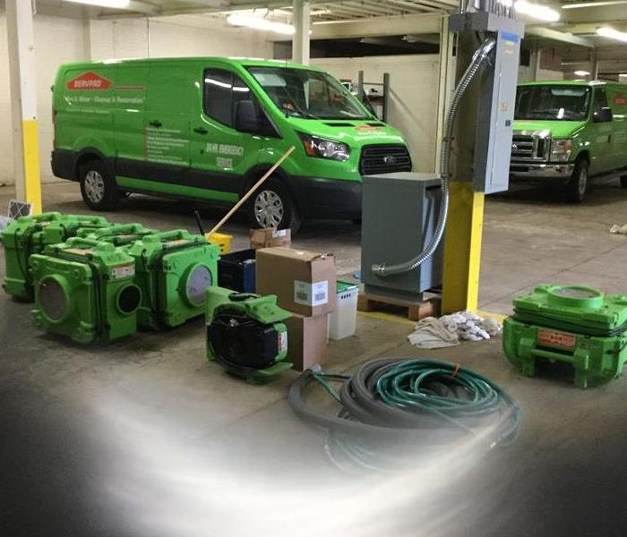 SERVPRO equipment and vehicles in a warehouse.