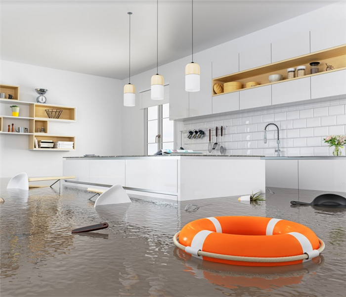 flooded kitchen with chairs floating